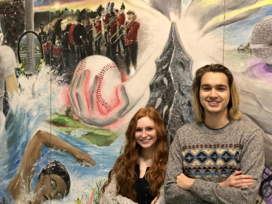 Jonah+Gibson+and+Melanie+Davis+standing+by+the+school+mural