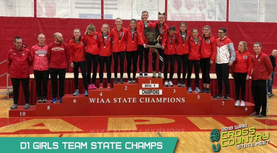 Image+of+Varsity+Girls+Cross+Country+team+receiving+the+WIAA+State+Champions+award+for+2018