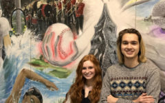 Jonah Gibson and Melanie Davis standing by the school mural