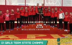 Image of Varsity Girls Cross Country team receiving the WIAA State Champions award for 2018