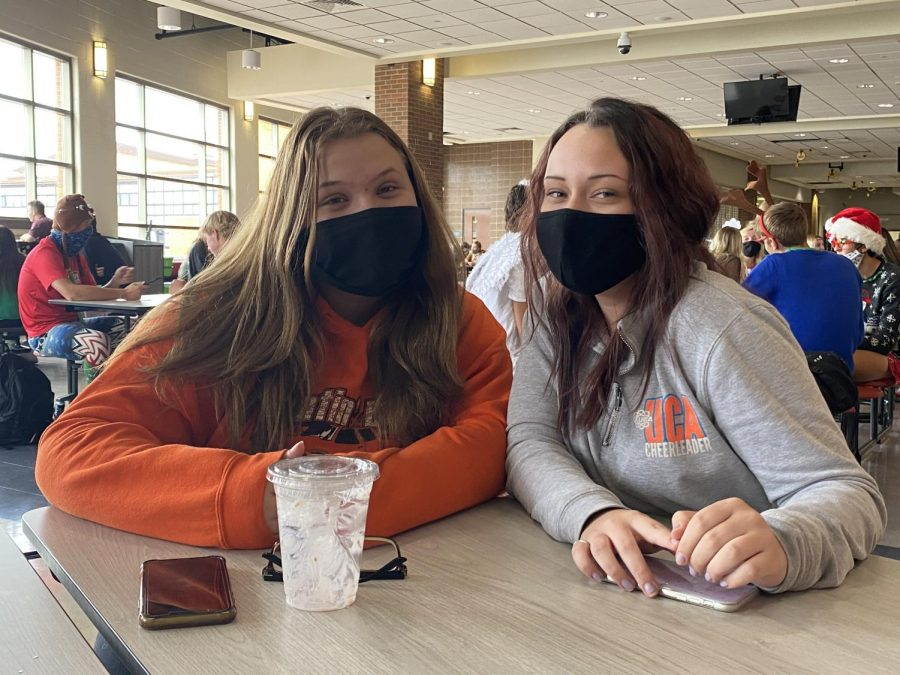 Ashlynn Banks and Alexis Riva during lunch, doing their best at social distancing at school
